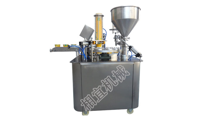 Automatic filling and sealing ma