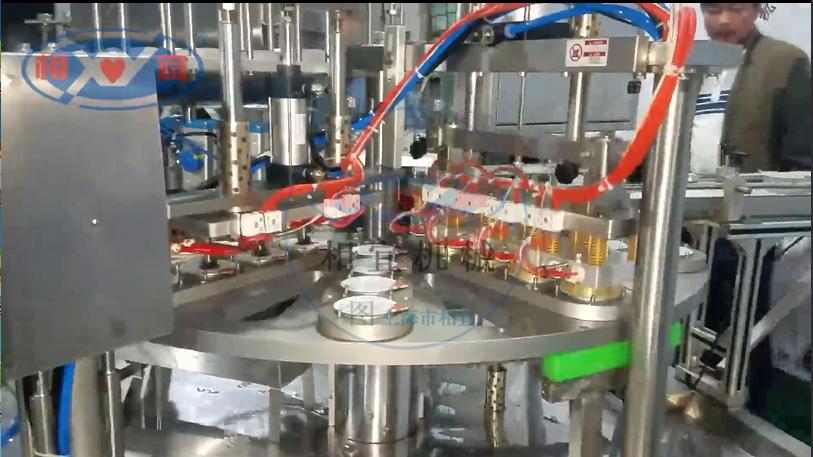 4杯圆盘灌装片膜机